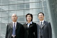 Businessmen and woman standing in a row