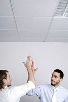 Businessmen giving high five