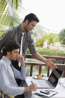 Businessmen looking at laptop