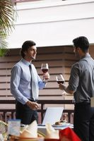 Businessmen with wineglasses