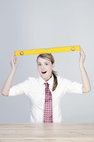 Businesswoman balancing a spirit level on her head