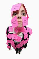 Businesswoman covered with adhesive notes looking angry