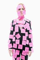 Businesswoman covered with adhesive notes
