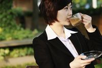 Businesswoman enjoying coffee at an outdoor cafe