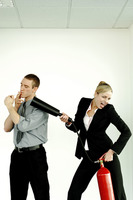 Businesswoman extinguishing her colleague for smoking in the office