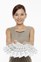 Businesswoman handing out a pile of cash