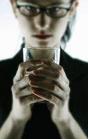 Businesswoman holding a glass of water