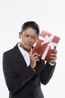 Businesswoman holding a red gift box