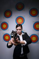 Businesswoman holding gun