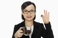 Businesswoman holding up a coffee bean