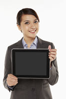 Businesswoman holding up a digital tablet