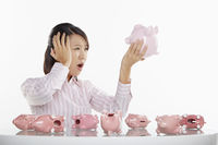 Businesswoman holding up a piggy bank