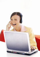Businesswoman laughing while talking on the hand phone