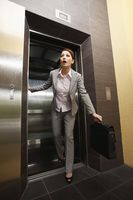 Businesswoman rushing out of the elevator