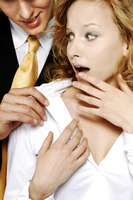 Businesswoman shocked with her colleague's behavior
