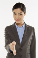 Businesswoman showing hand greeting gesture