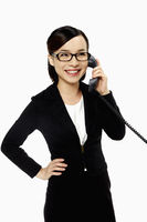 Businesswoman smiling and talking on the phone