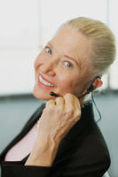Businesswoman talking on headset at airport lounge