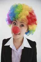 Businesswoman wearing a clown's wig and nose