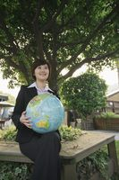 Businesswoman with a globe