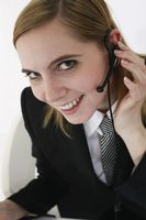 Businesswoman with headset using laptop