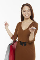 Cheerful woman carrying shopping bags