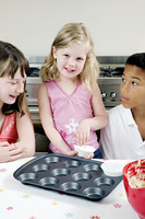 Children baking cake in the kitchen