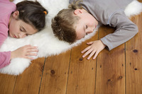 Children sleeping on the floor