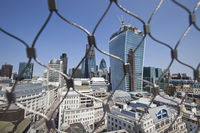 City of london behind wire net at the top of the monument,london