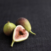 Close up of some figs on table