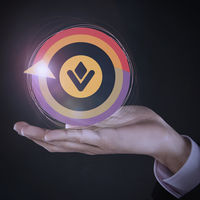 Colorful circular logo on top of human hand
