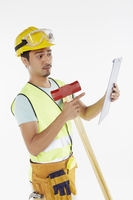 Construction worker holding a hammer and clip file