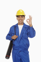 Construction worker showing hand gesture