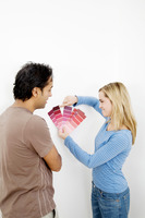 Couple choosing suitable colour from the colour chart