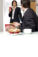 Couple having breakfast before going to work