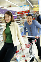 Couple having fun shopping in the supermarket