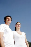 Couple in white smiling