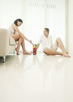 Couple playing plastic blocks at home