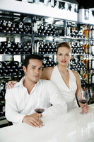 Couple posing at bar counter