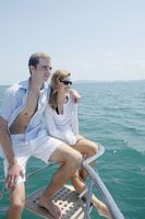 Couple relaxing at the tip of the yacht