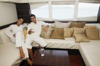 Couple relaxing in yacht living room