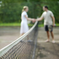 Couple shaking hands after the tennis match
