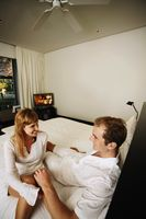 Couple talking to each other in resort bedroom