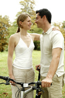 Couple with their bicycle in the park