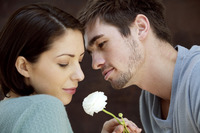 Couple with white rose in between