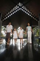 Family walking into resort while holding hands