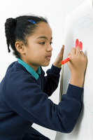 Girl colouring picture on drawing board
