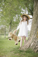 Girl going for a walk with teddy bear