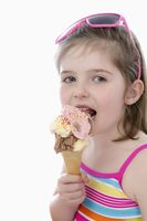 Girl in swimwear eating ice-cream