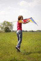 Girl playing with a kite